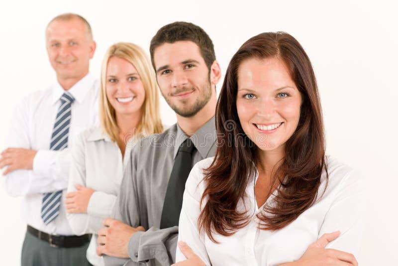 Condizione felice della squadra di affari nella riga ritratto immagine stock libera da diritti
