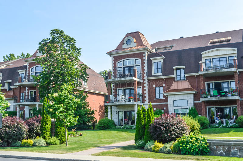 Condo building in Chambly downtown. Chambly, Canada - 24 juin, 2016: Condo building in Chambly downtown royalty free stock photos