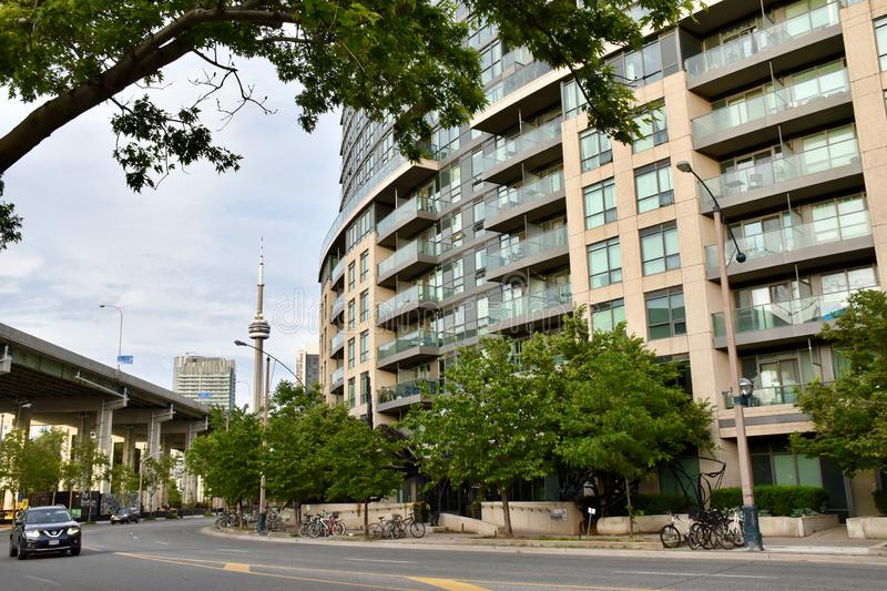 Condo Building Near Elevated Highway. New city residences located close to an elevated expressway, close to downtown Toronto. This condo building is part of a stock photo
