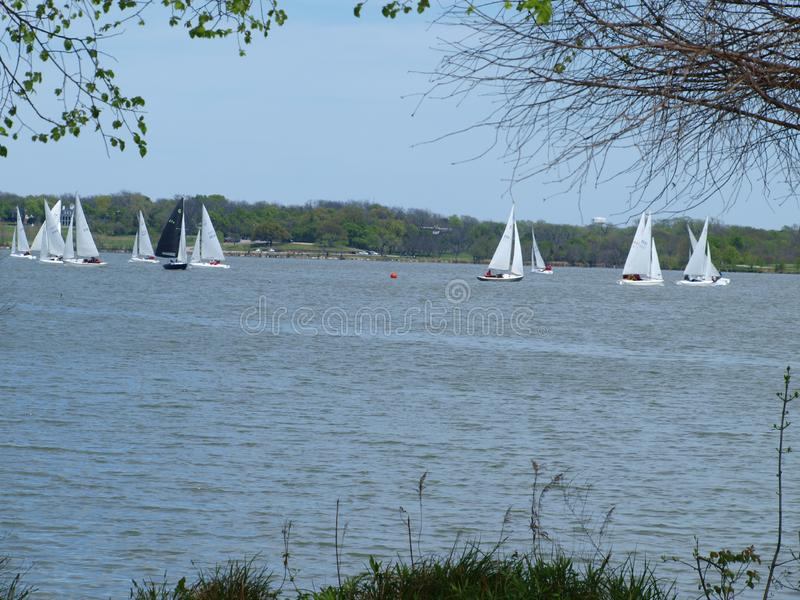 A Sail Boat Club Competition or Regata. This sailing club schedules these events on a regular basis. It`s always fun to wach from the shore line as they tak back stock photos