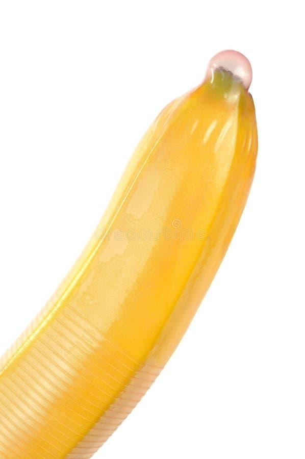 Condom sur la banane photographie stock