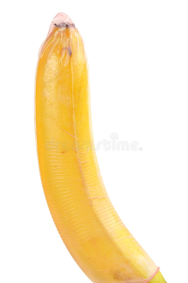 Condom sur la banane image libre de droits