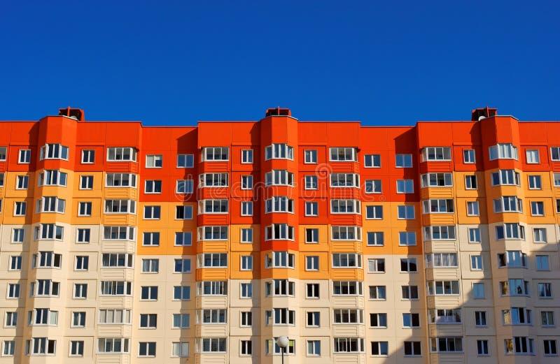 Condominio rosso ed arancio vivo fotografia stock