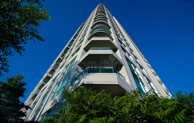 Condominium - Place To Live, Rising Tower Into Blue Summer Sky. Royalty Free Stock Photography
