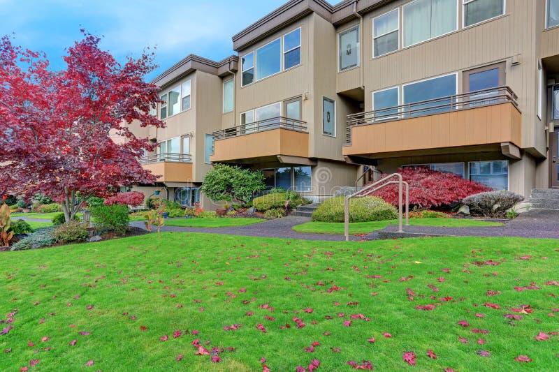 Condominium, apartment building with beige siding stock photo