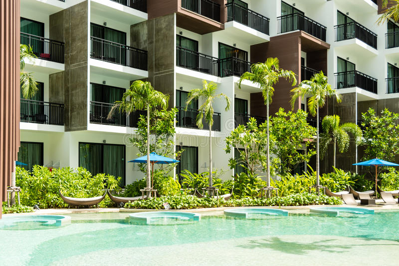 Condominium and swiming pool life of City people in modern town. stock photos