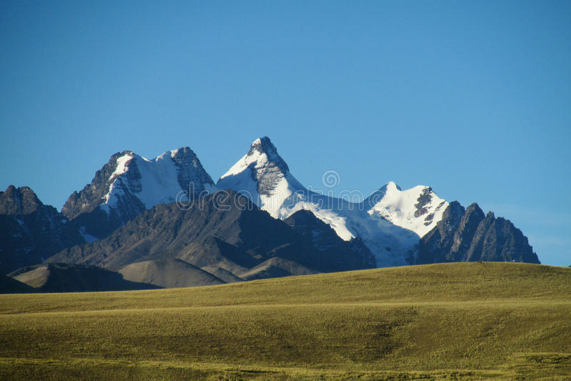 Condoriri mountain, Andes, Bolivia. Bolivia Andes Huayna Condoriri, snow covered mountain summit. Gray rock summit in Bolivian Andes near La Paz. Beautiful royalty free stock image