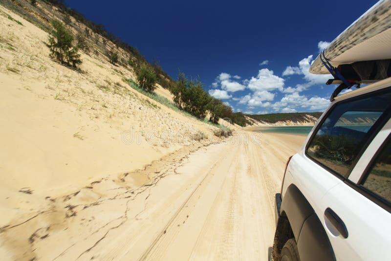 Conducción en la playa imagen de archivo