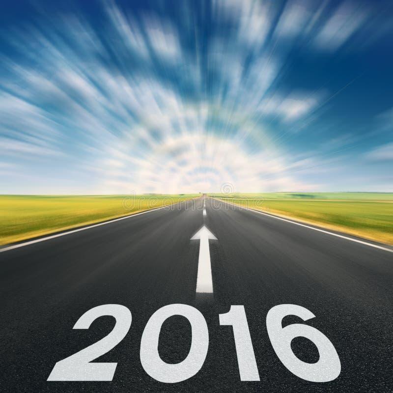 Conducción rápidamente en el concepto de la carretera de asfalto para 2016 imagen de archivo libre de regalías