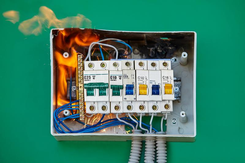Bad electric wiring systems became the cause fire. Conductor came loose at automatic circuit breaker which caused arcing and and soon switchboard to ignite of royalty free stock photos