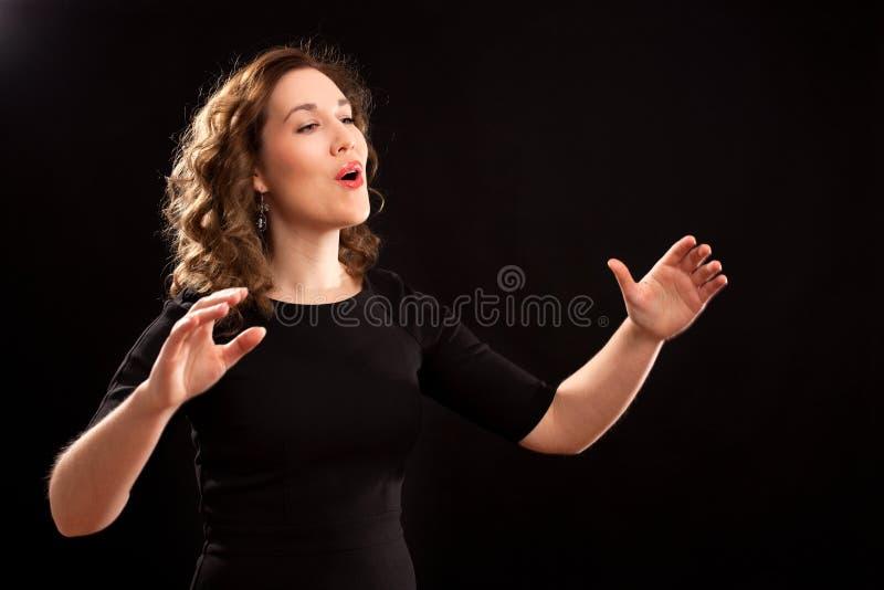 Conductor femenino del coro foto de archivo