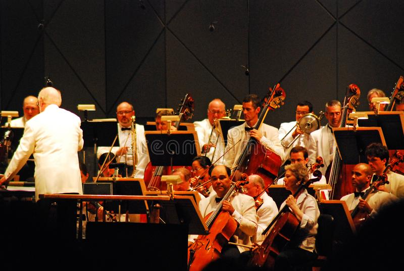 The performance of an orchestra. A conductor prepares his orchestra ahead of a performance at Tanglewood royalty free stock photos