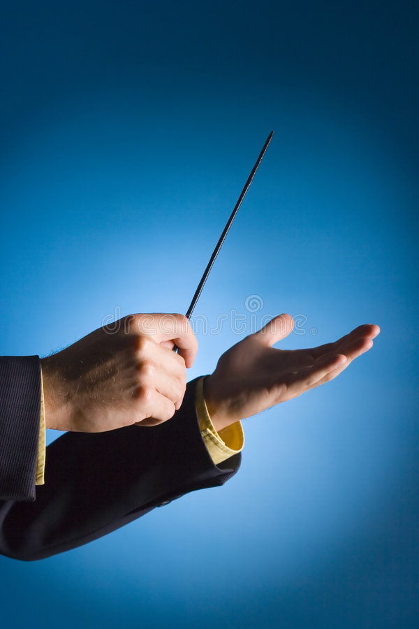 Conductor's hands. On blue background stock photo
