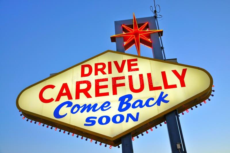 Conduisez soigneusement revenu bientôt image stock