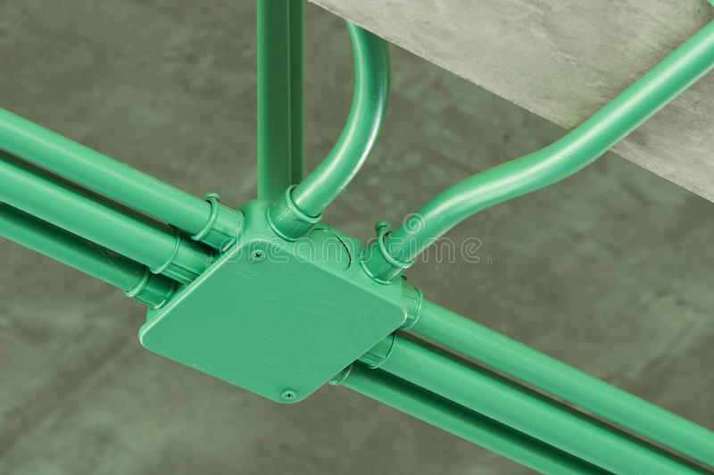 Conduit. Installed Conduit painted with green color stock photos