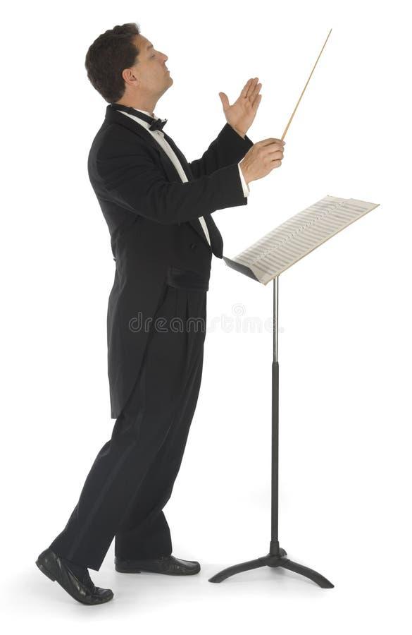 Conduttore di orchestra su bianco immagini stock