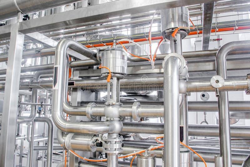 Condutture da acciaio inossidabile, un sistema per i liquidi di pompaggio o fotografia stock libera da diritti