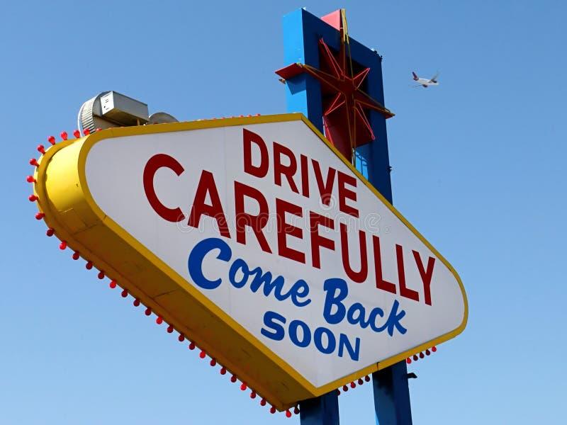 Conduza com cuidado, voltado logo assinam dentro Las Vegas com avião de partida imagens de stock royalty free