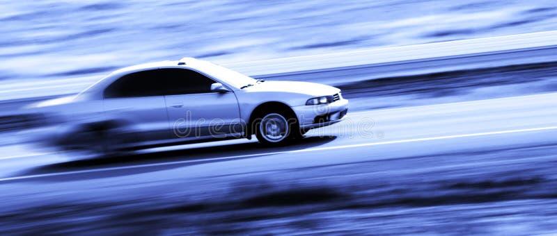 Conduzindo um carro rápido imagens de stock