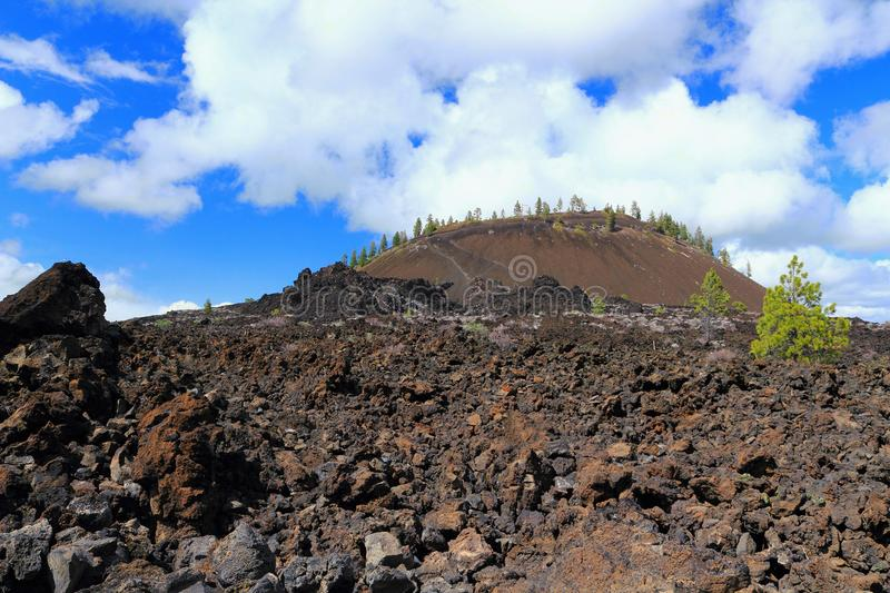 Landscape of Lava Butte Cinder Cone and Lava Fields in Newberry National Volcanic Monument, Oregon, USA royalty free stock images