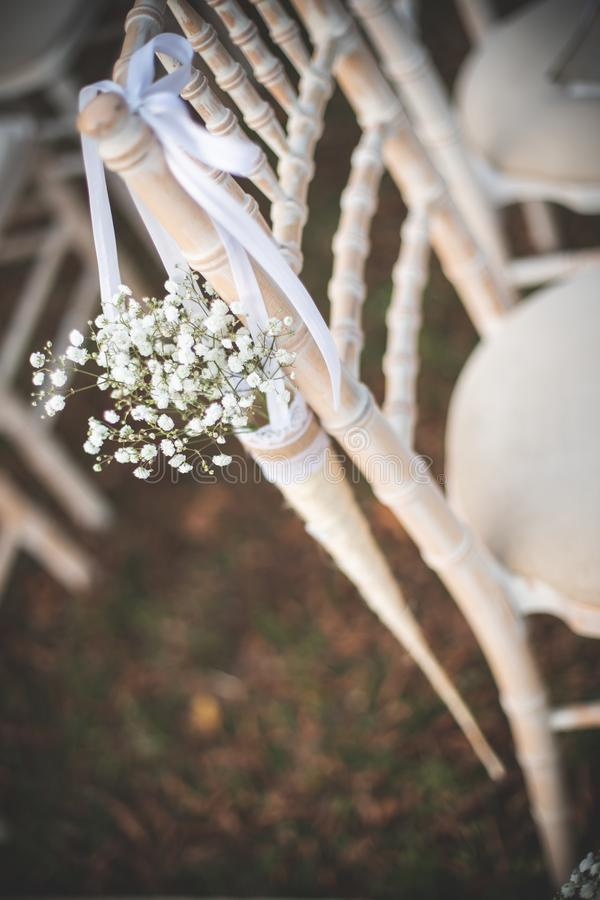 Cone. Gypsophila in cone on the chair as a wedding decoration stock images