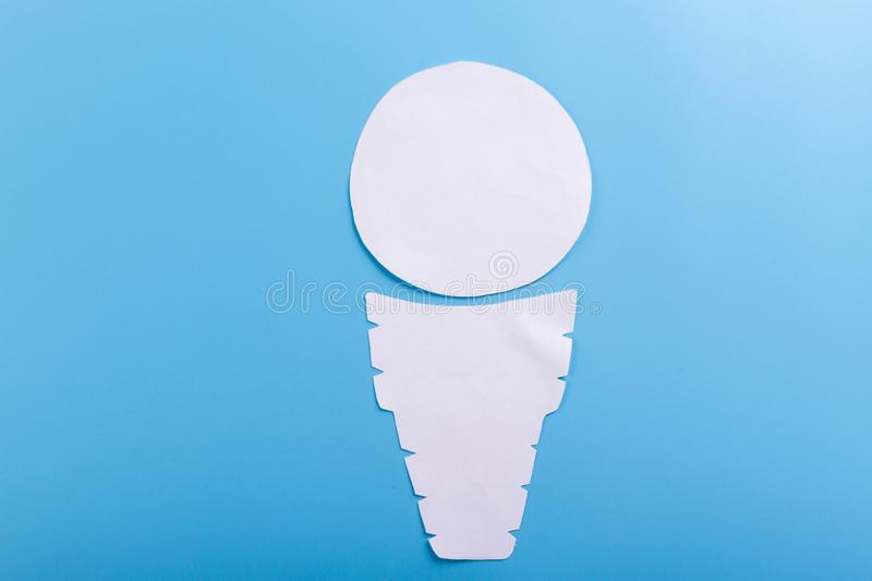 Cone with icecream. On the blue background stock image