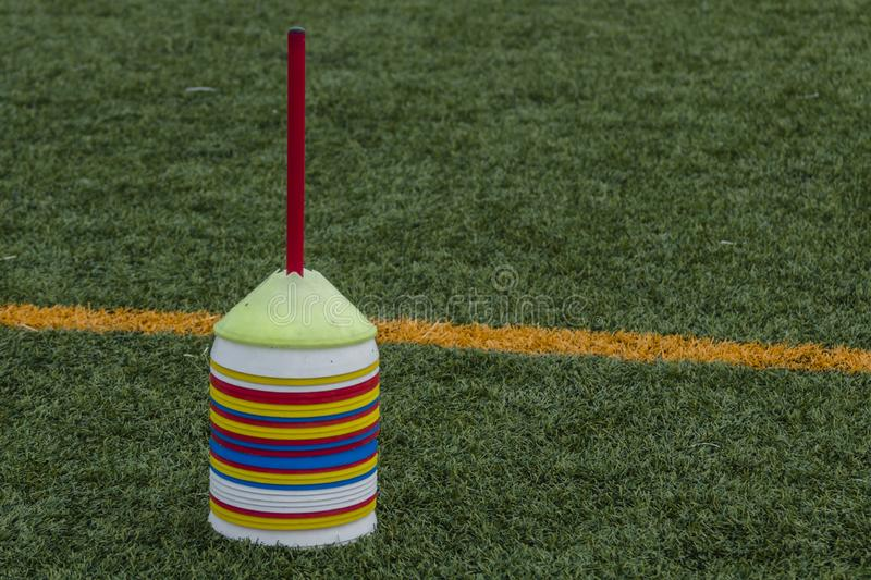 Cone Tool for Training on Artificial Grass in Soccer Academy stock images