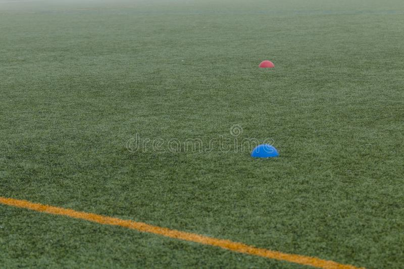 Cone Tool for Training on Artificial Grass in Soccer Academy royalty free stock photography