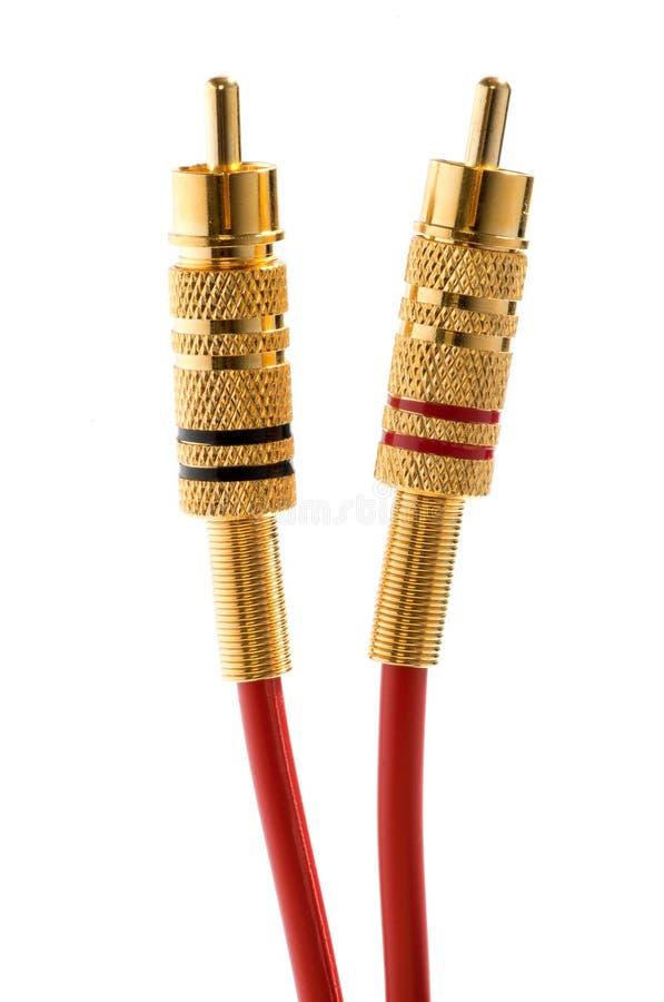 Conectores RCA y cables de cobre amarillo fotografía de archivo libre de regalías