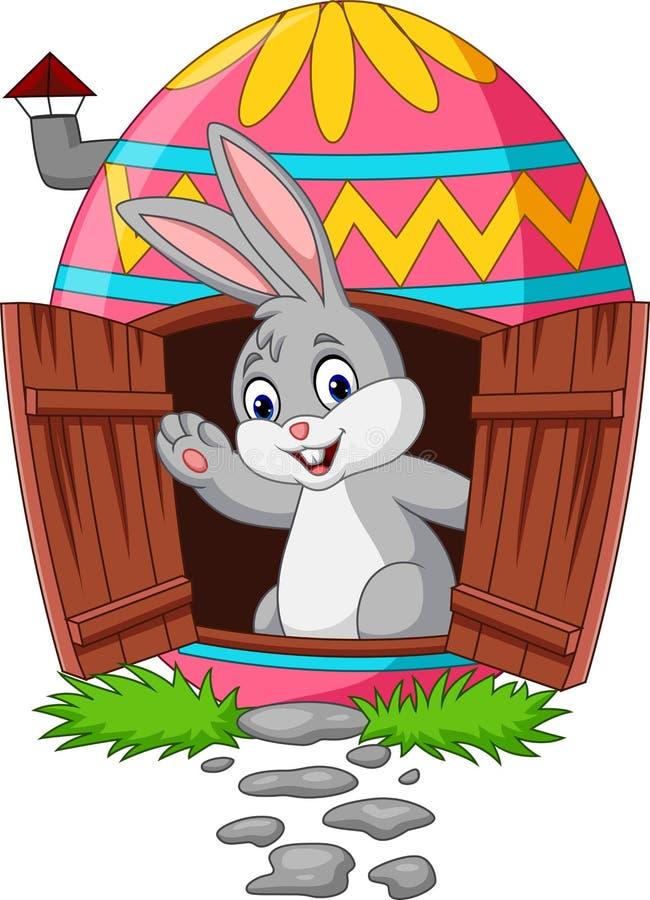 Conejito de la historieta con la casa adornada de los huevos de Pascua stock de ilustración