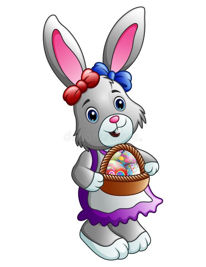Conejito de pascua de la historieta que lleva una cesta por completo de huevos stock de ilustración