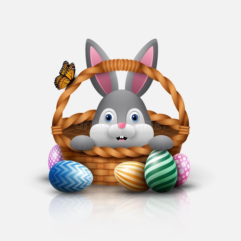 Conejito de pascua lindo en una cesta con los huevos coloridos en un fondo blanco libre illustration