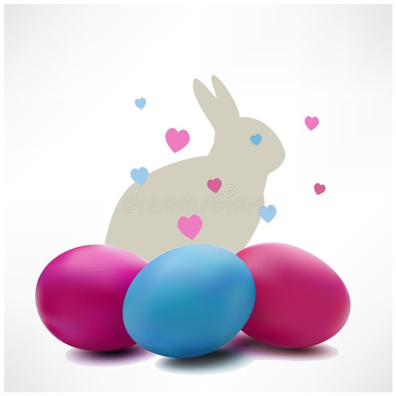 Conejo de Pascua y ejemplo colotful de los huevos de Pascua fotografía de archivo libre de regalías