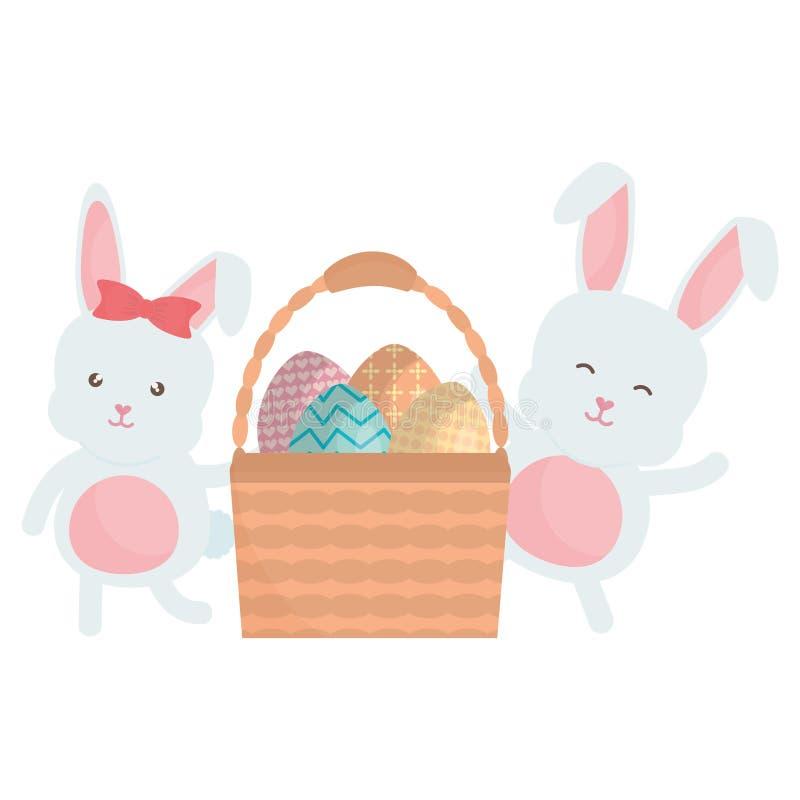 Conejos lindos con los huevos de Pascua pintados en cesta stock de ilustración