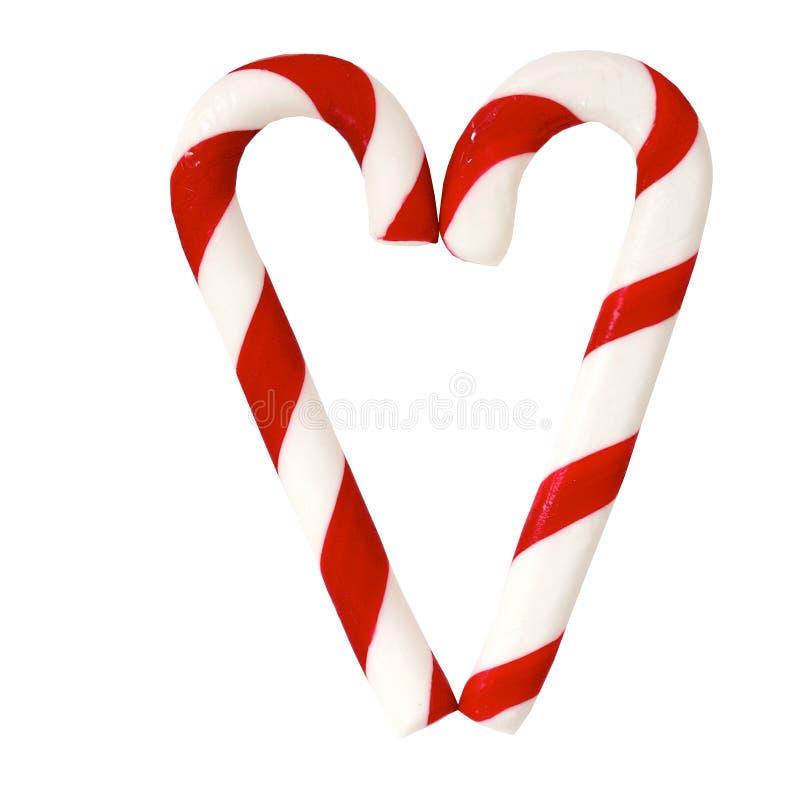 Cones dos doces de açúcar do Natal que dão forma a um coração fotos de stock