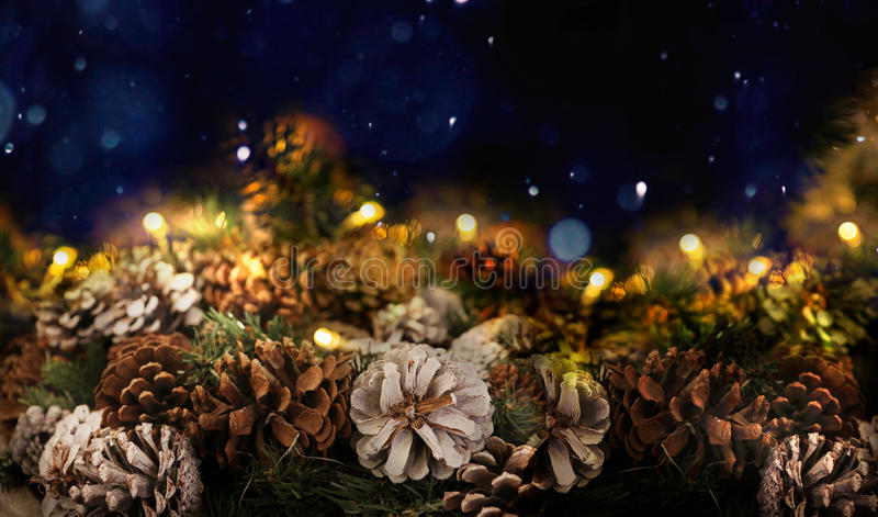 Cones and a garland on a dark blue background. Christmas decorations. New Year decoration Christmas tree royalty free stock photography