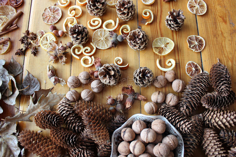 Cones, nuts, anise, leaves, cinnamon on the table royalty free stock photography