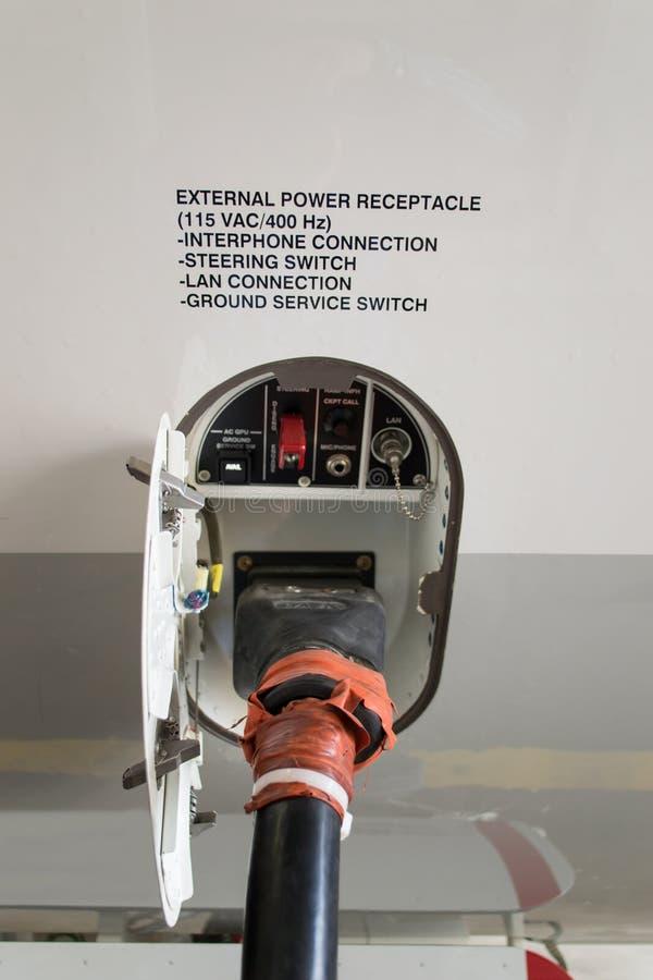 Conexión de poder del aeroplano imagenes de archivo