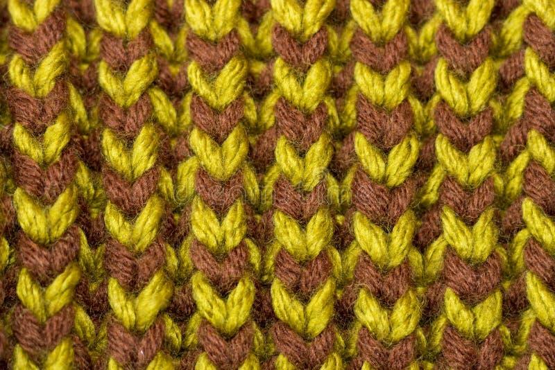 Confecção de malhas Textura feita malha fundo Agulhas de confecção de malhas brilhantes imagem de stock royalty free