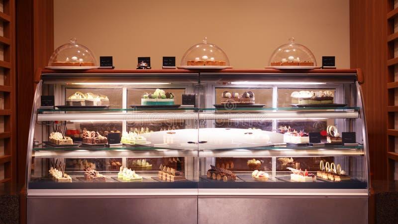 Confectionary shop display background. Sweet treats variety. Sma stock photos