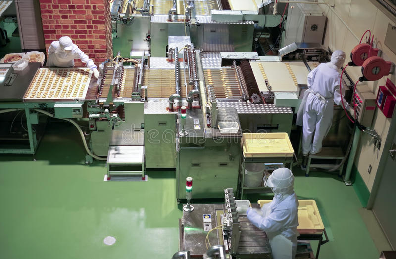 Confectionery factory on production cookie stock photos