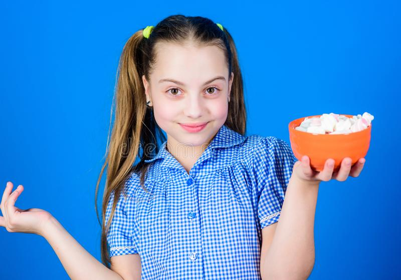 Confectionery. happy little child love sweets and treats. Small girl eat marshmallow. marshmallow. Candy shop. Healthy stock image