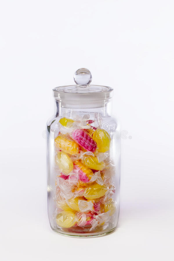 Confectionery. Jar of boiled sweets in wrappers isolated against stock images