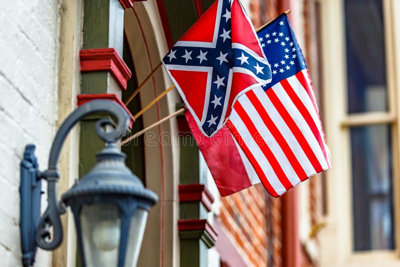 Confederate battle flag and 34 stars American Civil War Flag attached to the building, historic downtown of Gettysburg, stock photography