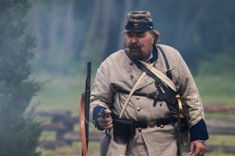 Confederate Commander. Civil War era soldiers in battle at the Dog Island reenactment in Red Bluff, California stock image
