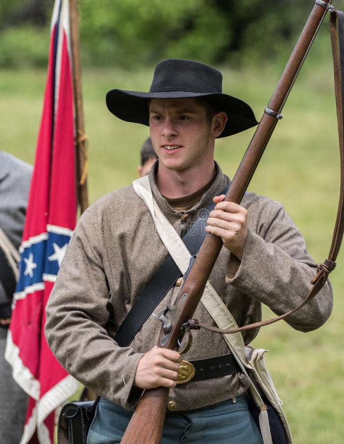 Confederate Soldier. Civil War era soldiers in battle at the Dog Island reenactment in Red Bluff, California stock photos