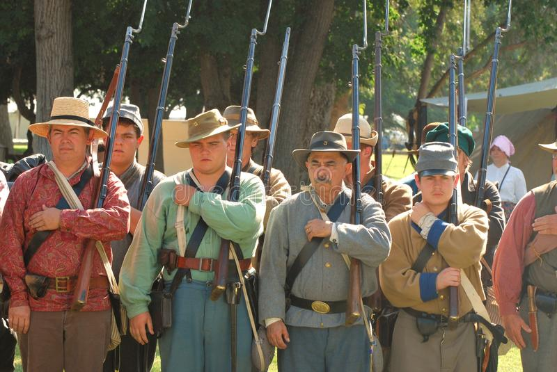 Confederate soldiers stand in review II. A group of confederate soldiers stand in review before battle during the 22nd Annual Civil War Revisited on October 22 royalty free stock photo