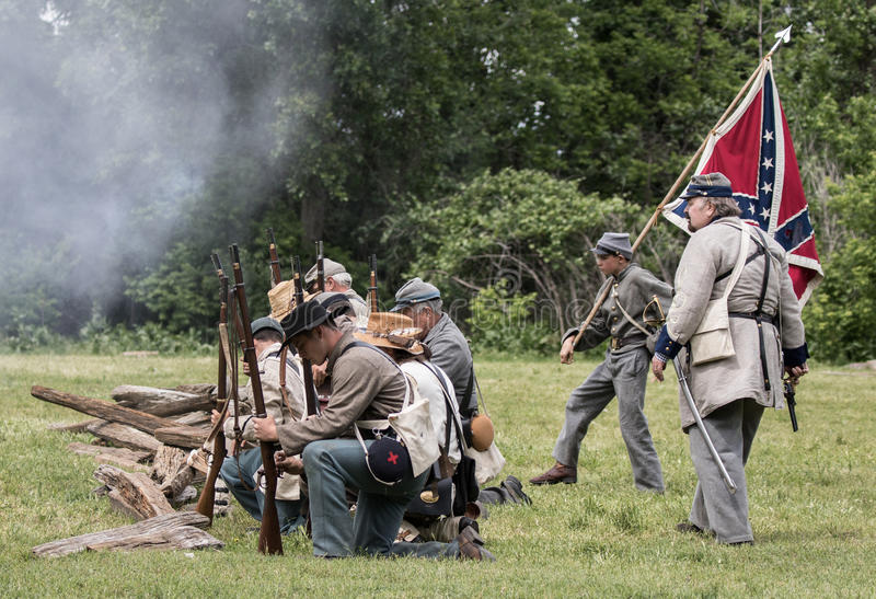 Confederates at War. Civil War era soldiers in battle at the Dog Island reenactment in Red Bluff, California royalty free stock photography
