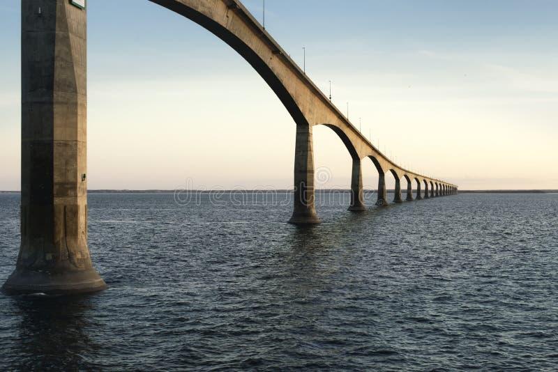 Confederation Bridge over sunset sky, Northumberland Strait, Prince Edward Island, Canada royalty free stock images