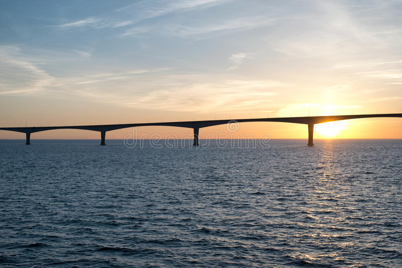 The Confederation Bridge over sunset sky royalty free stock photography